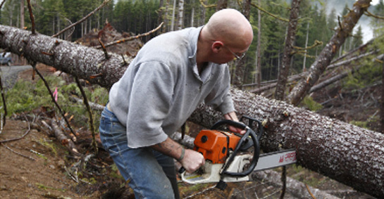 ax man with chainsaw
